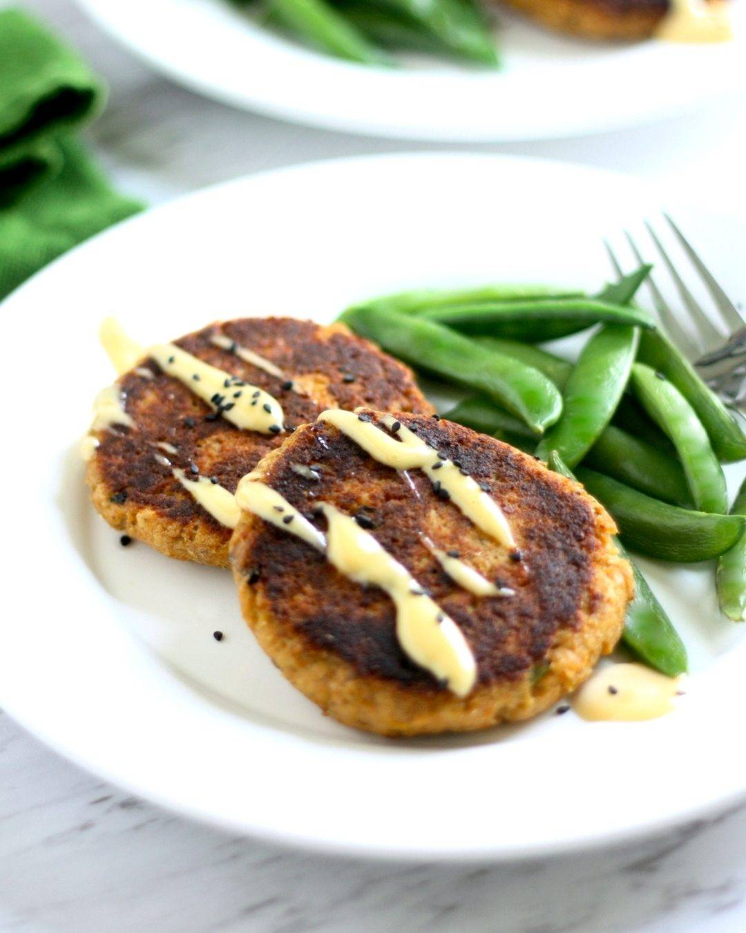 Plate with Salmon Patties and Steamed Sugar Snap Peas