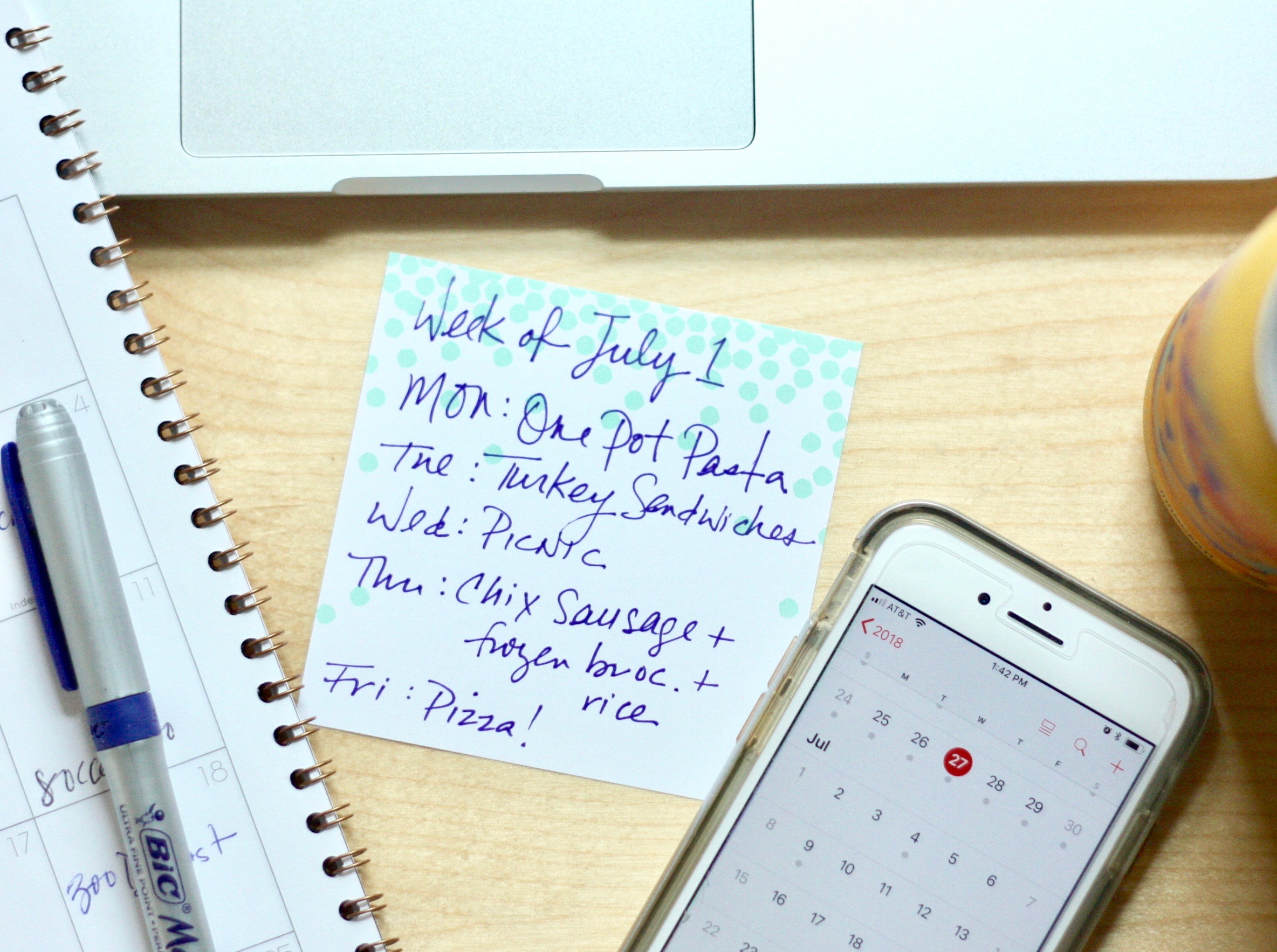 Image showing a desk with computer, iPhone, and meal plan notes