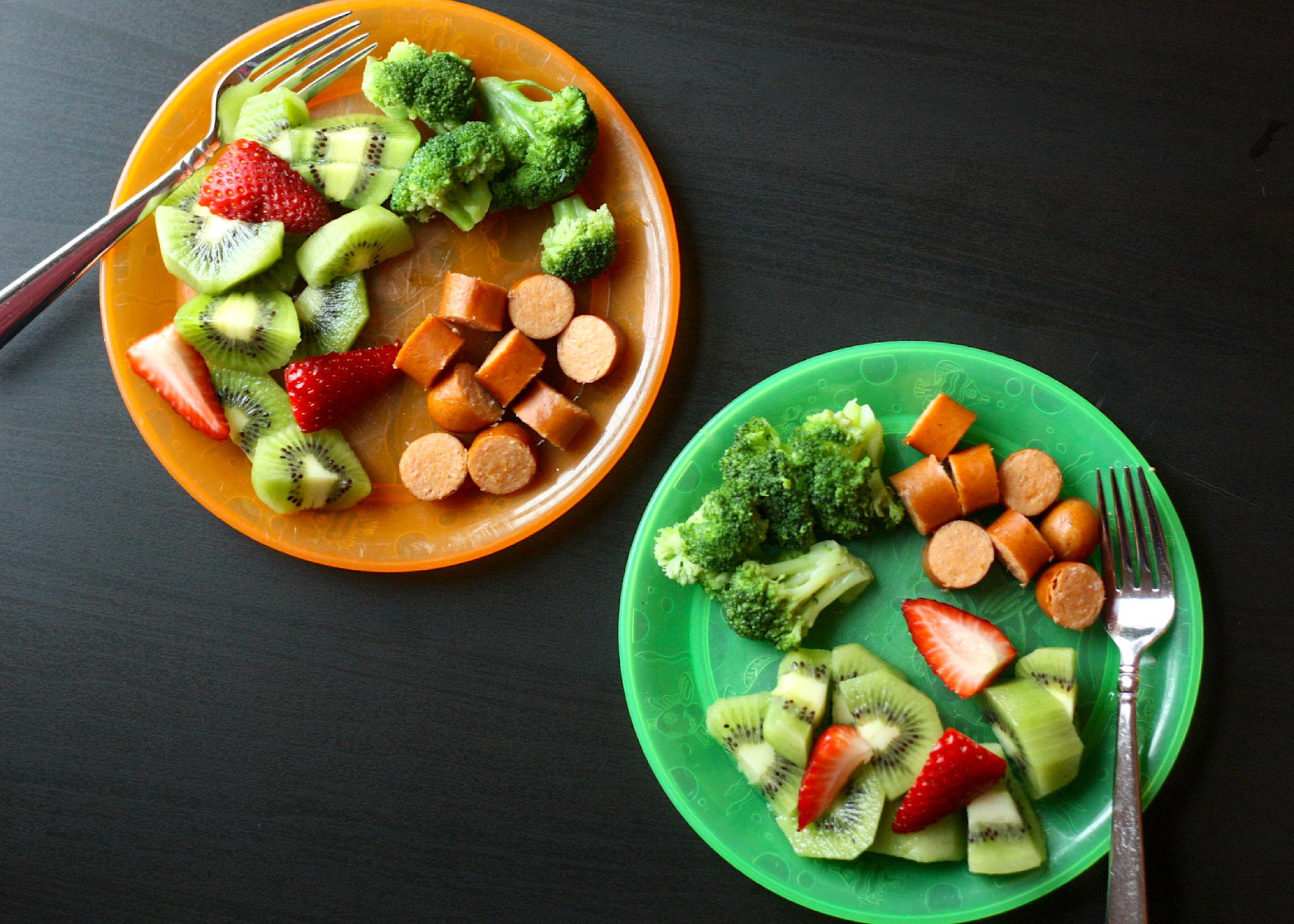 Feeding kids chicken hotdogs, frozen broccoli and fruit