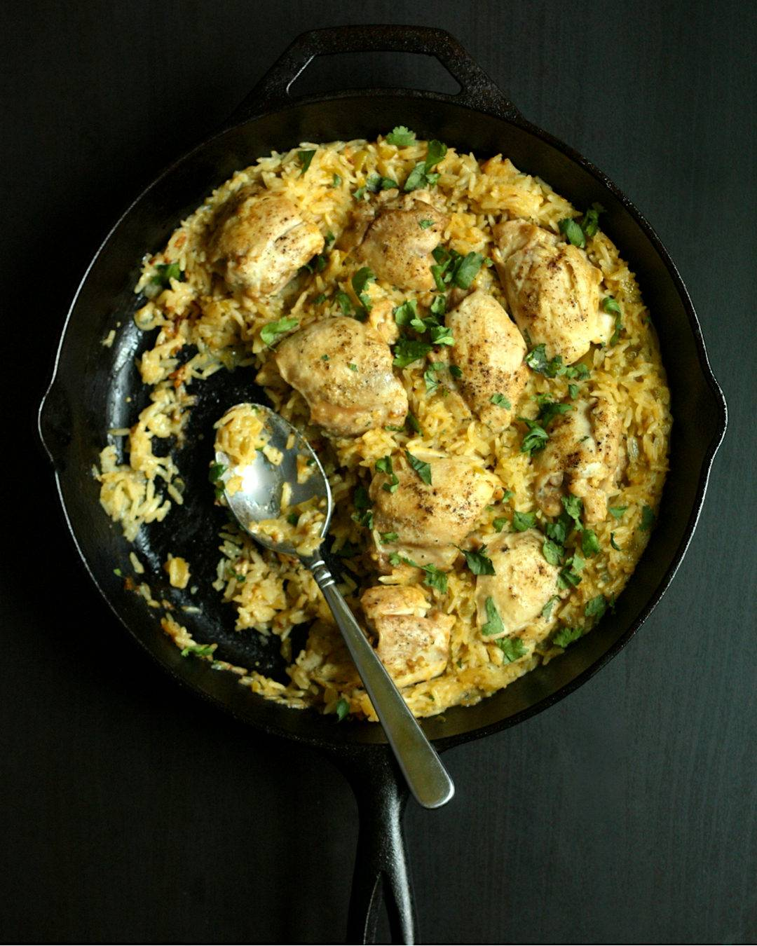 Cast Iron Skillet with Chicken Thighs and Rice