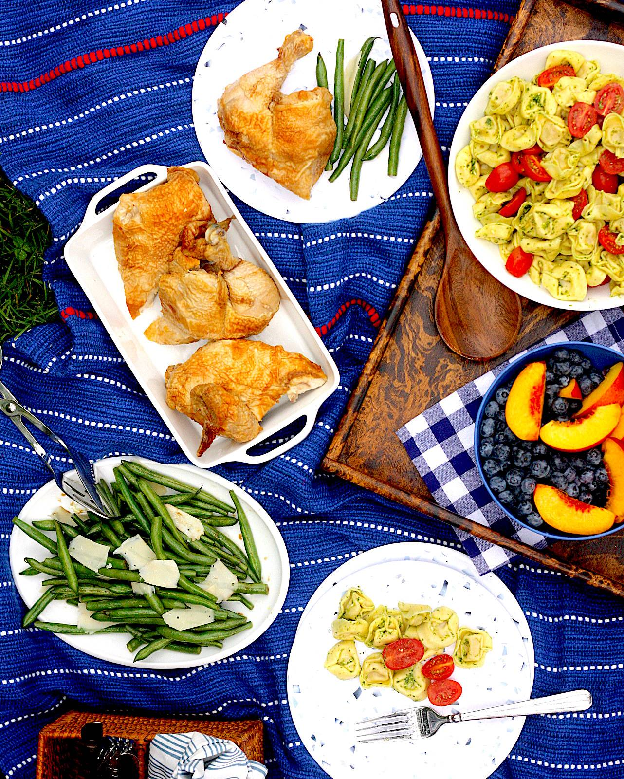 Picnic spread on a blanket on the grass